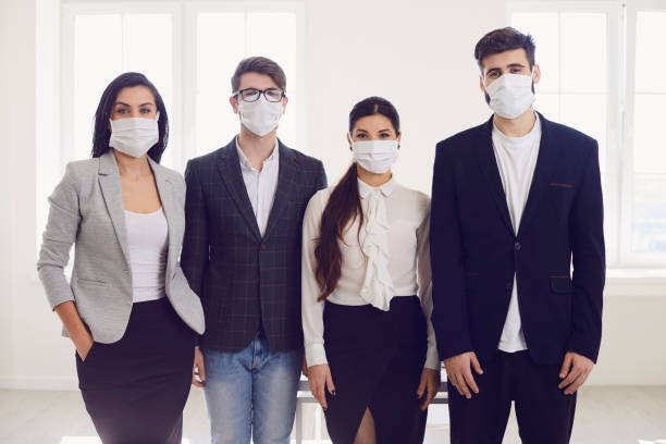 Danger of infection of the virus coronavirus infection. Group people businesspeople in medical mask at office. stock photo