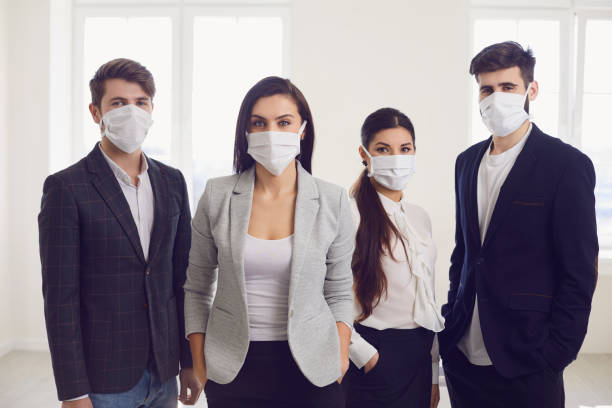 danger of infection of the virus coronavirus infection. group people businesspeople in medical mask at office. - businessman covid mask foto e immagini stock
