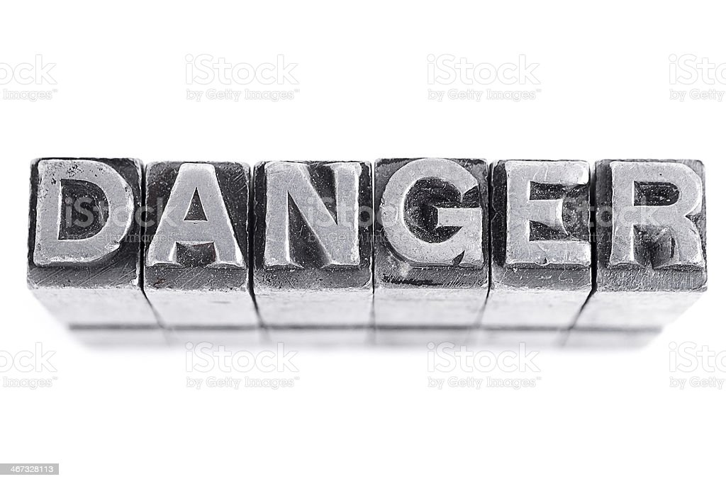 Danger sign, antique metal letter type royalty-free stock photo