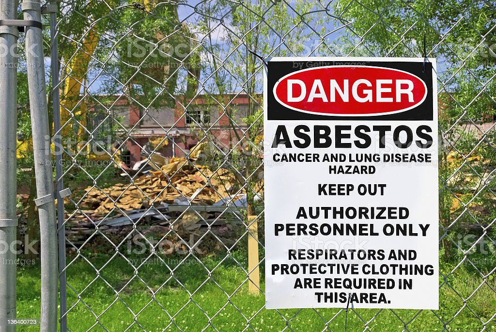 Danger sign of asbestos outside restricted area stock photo