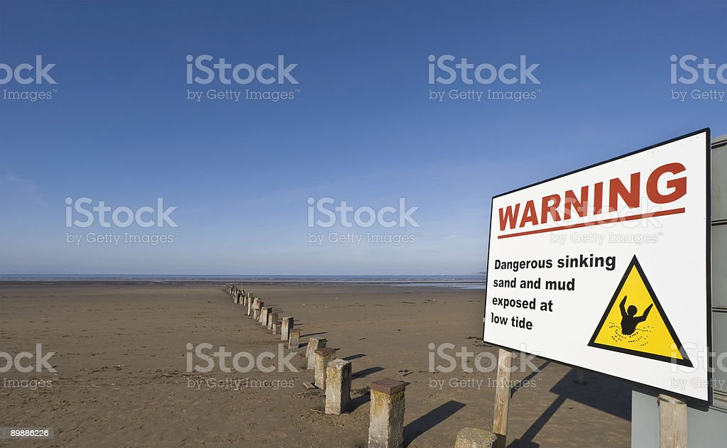 Danger Sign On A Sunny Beach royalty-free stock photo
