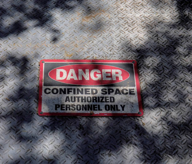 Danger Sign. A man hole often post a warning sign. confined space stock pictures, royalty-free photos & images