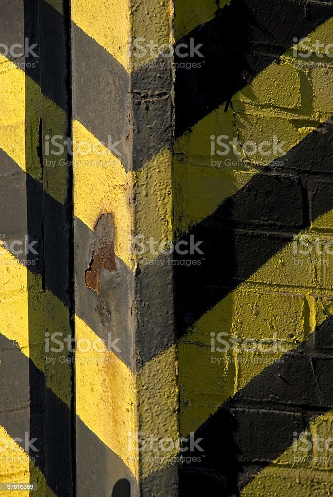 Danger signals in yellow and black on old brick masonry royalty-free stock photo