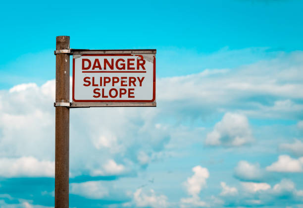 Danger Slippery Slope warning sign on Quayside Danger Slippery Slope warning sign on Quayside slippery stock pictures, royalty-free photos & images