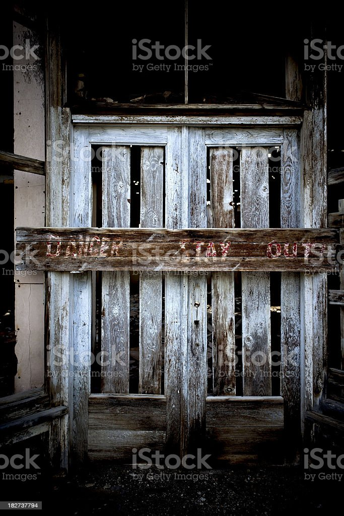 Danger Stay Out Boarded Up Doorway. royalty-free stock photo