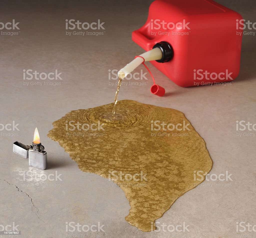 Danger; Tipped Red Gasoline Can Spilling With Fire Near stock photo