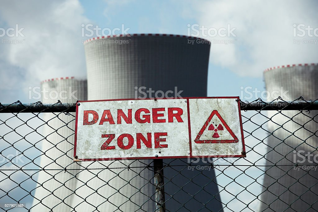Warning sign on the fence at nuclear power plant