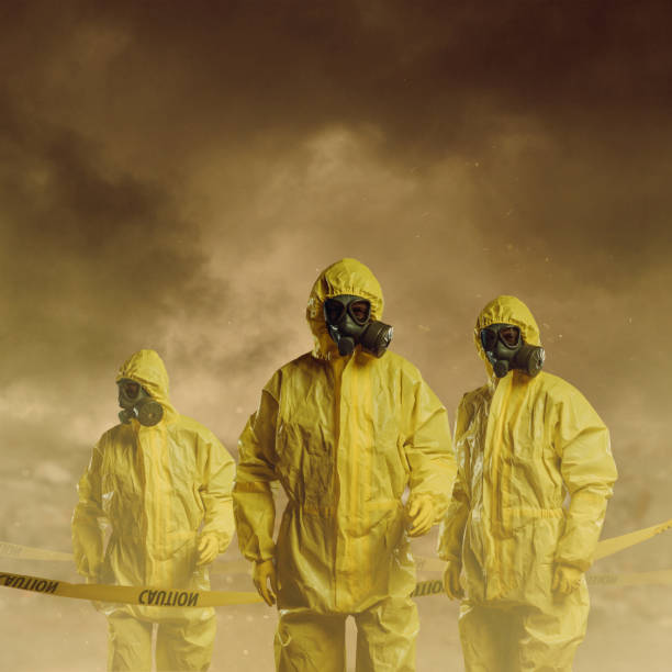 Danger zone Men wearing protective suit with caution tape. Danger zone concept. decontamination stock pictures, royalty-free photos & images