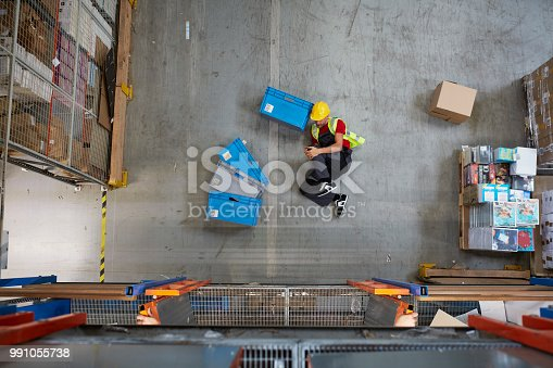 Man lying on the floor. Accident in warehouse