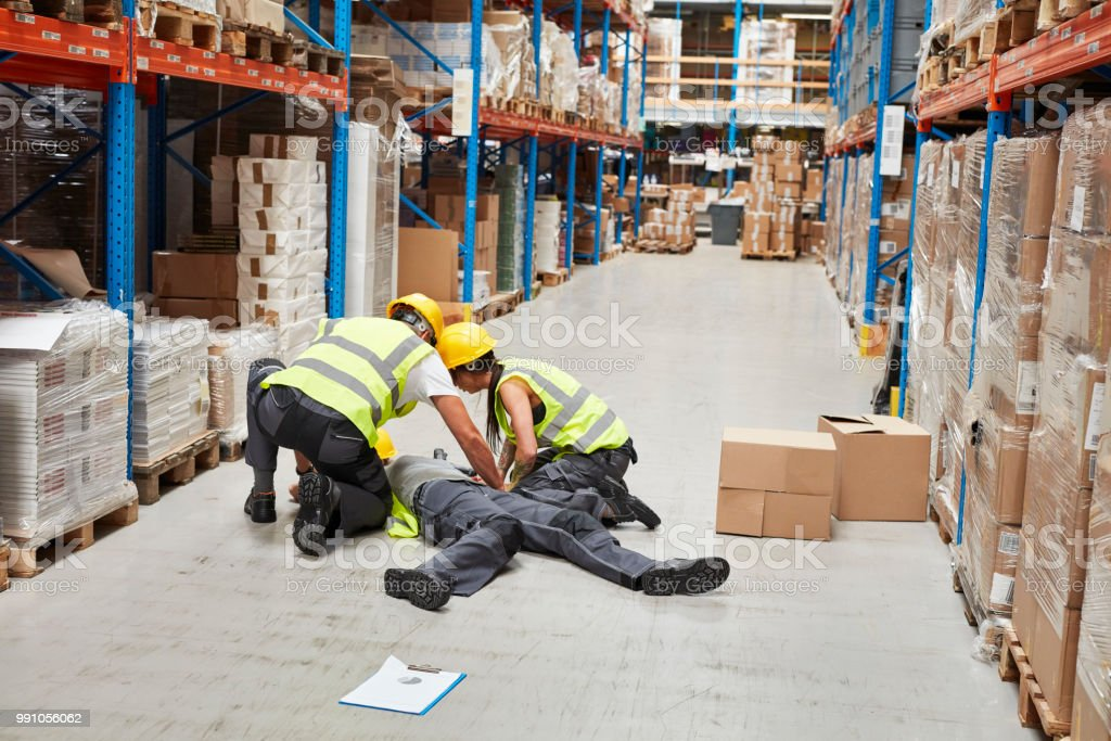 Dangerous accident during work. First aid stock photo