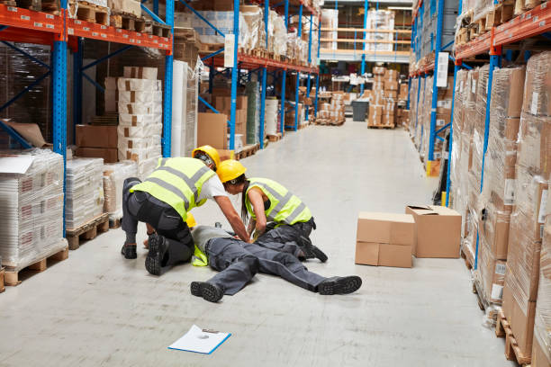 Dangerous accident during work. First aid Woman lying on the floor. Accident in warehouse misfortune stock pictures, royalty-free photos & images