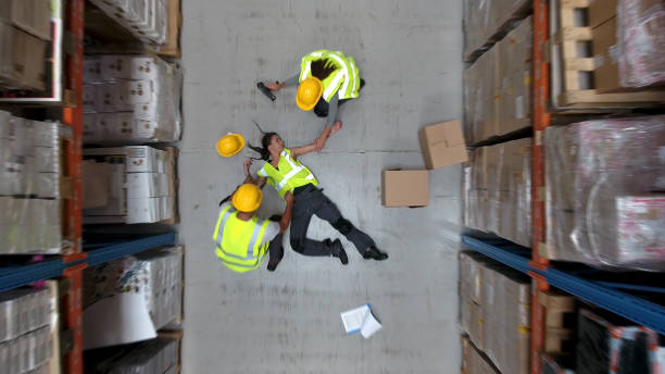 Dangerous accident during work. Warehouse aerial view stock photo