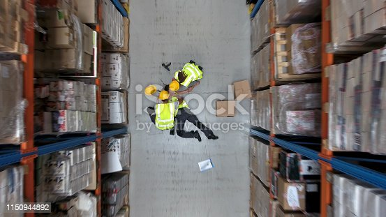 Woman lying on the floor. Accident in warehouse