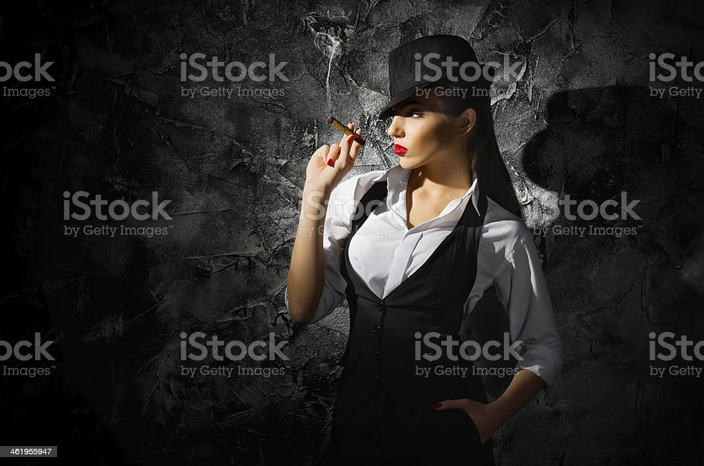Dangerous And Beautiful Criminal Girl With Cigar Stock