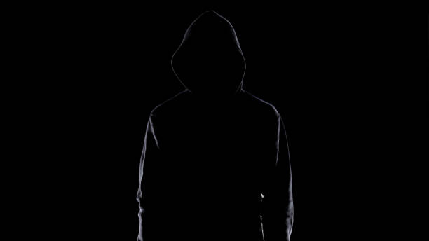 Dangerous anonymous male in night darkness, scary terrorist preparing for crime Dangerous anonymous male in night darkness, scary terrorist preparing for crime creepy stalker stock pictures, royalty-free photos & images
