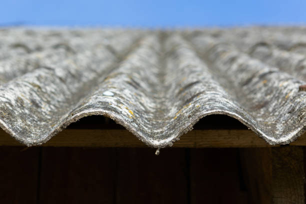 Dangerous asbestos roof. Asbestos dust in the environment. Health problems stock photo