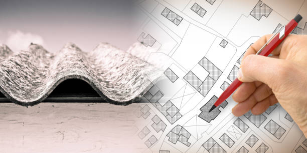Dangerous asbestos roof: one of the most dangerous materials in buildings - concept image with hand drawing on an imaginary city map - foto stock