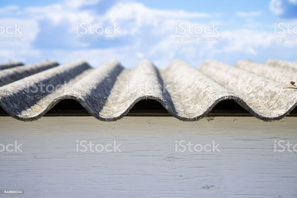 Dangerous asbestos roof panels - one of the most dangerous materials in the construction industry stock photo