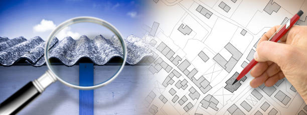 Dangerous asbestos roof seen through a magnifying glass: one of the most dangerous materials in buildings - concept image with hand drawing on an imaginary city map stock photo
