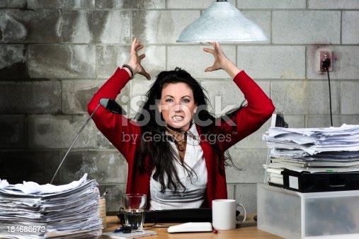 187928332 istock photo Dangerous business woman 184686672