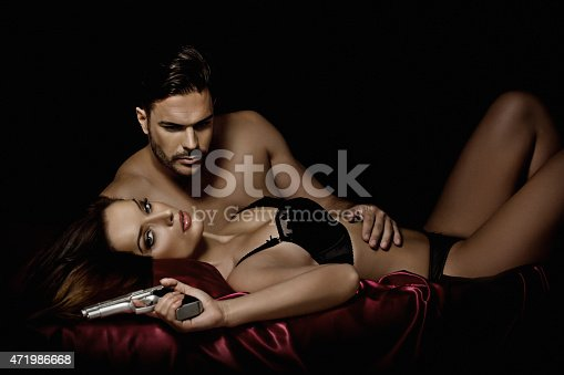 dangerous couple laying down in bed