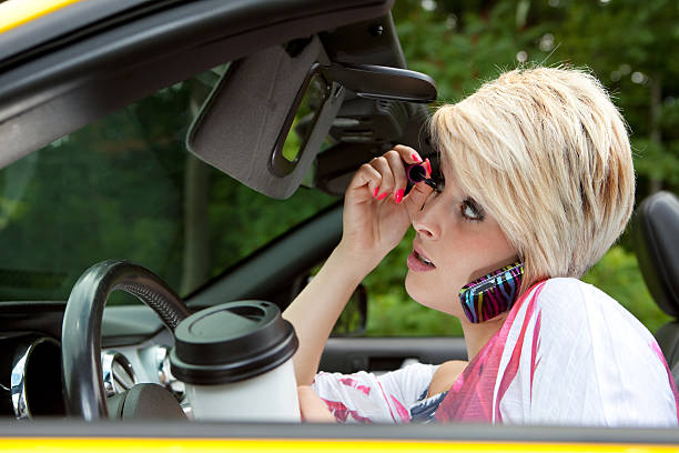 dangerous driving - detraction stock pictures, royalty-free photos & images