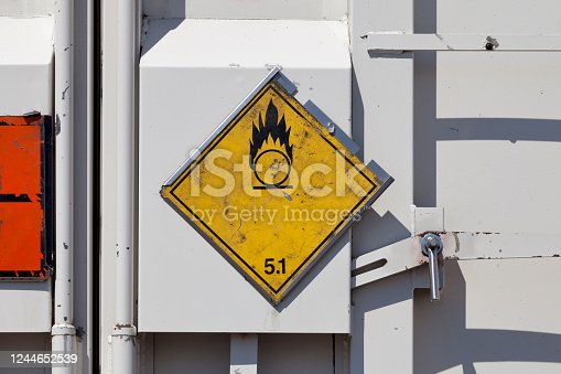 Dangerous goods sign on a truck back door. The yellow placard indicate that the good transported is an Oxidizing Agent.