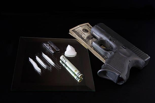 dangerous habit - money black background stock photos and pictures