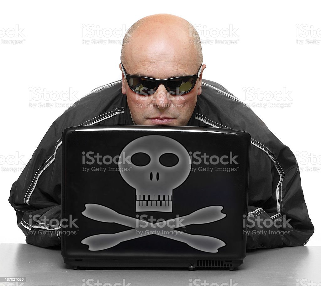 Dangerous hacker with laptop. Online crime metaphor. Adult Stock Photo