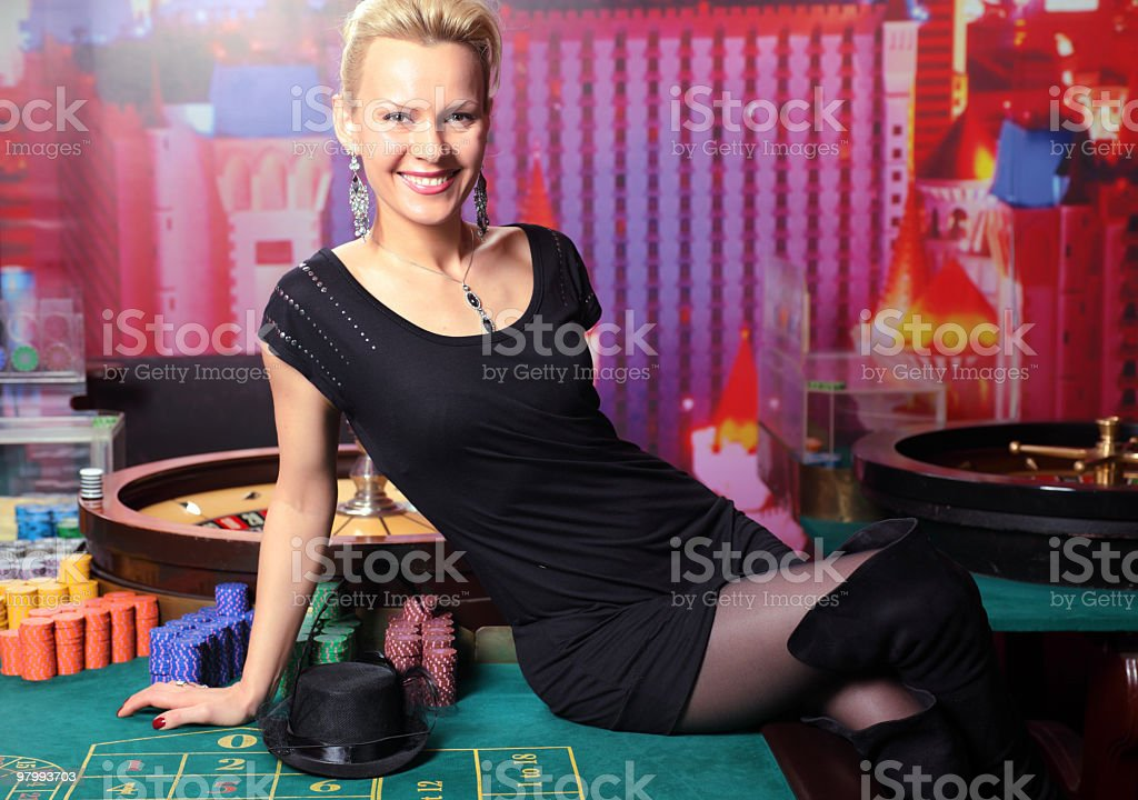 Dangerous lady sitting on the casino table. royalty-free stock photo
