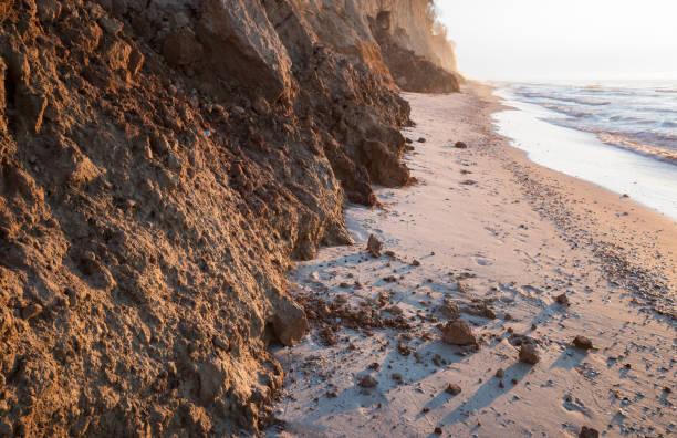 Dangerous landfall. Coastal landslide, danger of collapse. Dangerous landfall. Coastal landslide, danger of collapse. devolve stock pictures, royalty-free photos & images