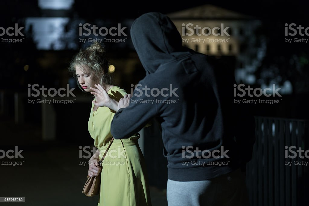 Dangerous man and young woman stock photo
