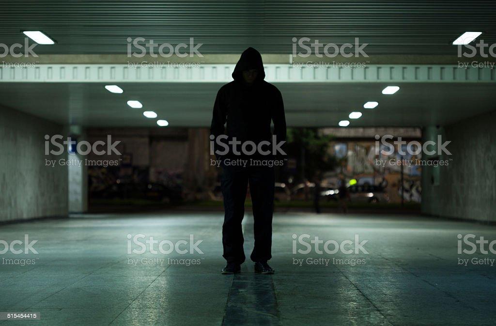 Dangerous man walking at night stock photo