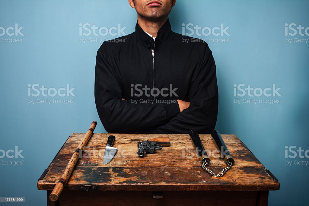 Dangerous man with various weapons royalty-free stock photo