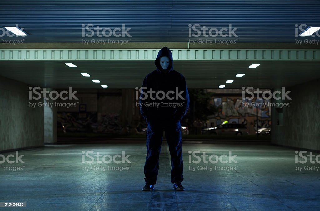 Dangerous mugger in the underpass stock photo