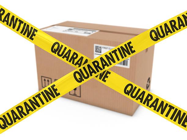Dangerous Parcel Concept - Cardboard Box behind Quarantine Tape Cross stock photo