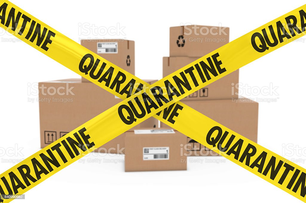 Dangerous Parcels Concept Stack of Cardboard Boxes behind Quarantine Tape stock photo