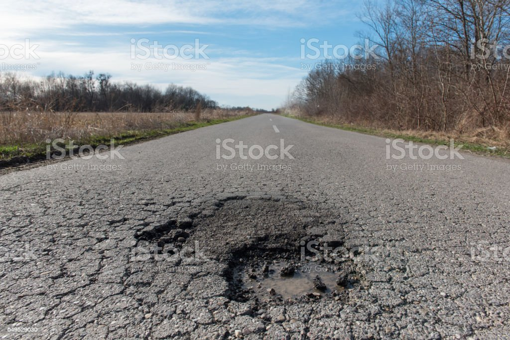 Dangerous Pot Hole on the Road stock photo