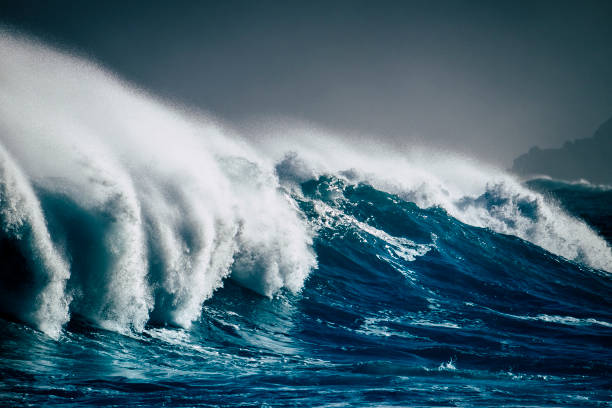 dangerous powerful energy wave big splash white foam and blue deep water - oceanic storm and bad weather climate change for world disease for temperature changed - surfer break point - autorità foto e immagini stock