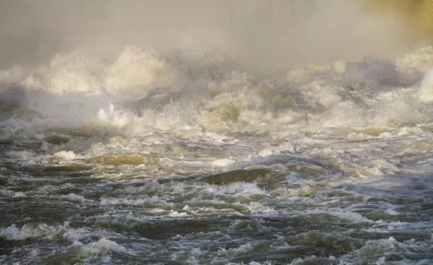Dangerous river rapids stock photo
