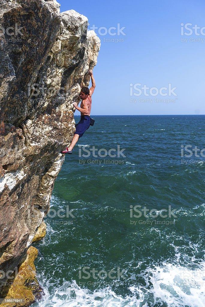 dangerous rock climbing move royalty-free stock photo