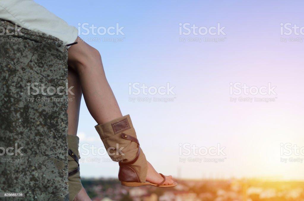 dangerous sitting on the stone stock photo