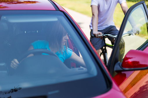 istock Dangerous situation with cyclist and car 1032694668