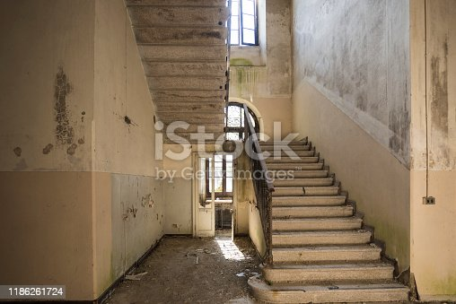 A dangerous stairway in an abandoned building