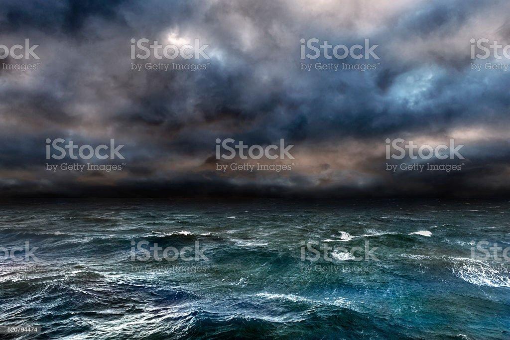 Dangerous storm over ocean Approaching storm over the ocean. Blue Stock Photo