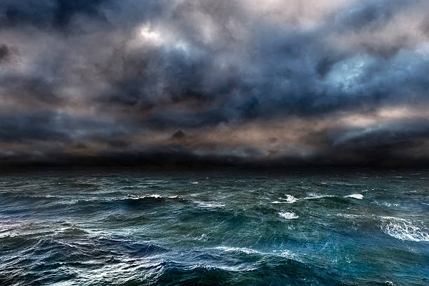 dangerous storm over ocean - rough stock photos and pictures