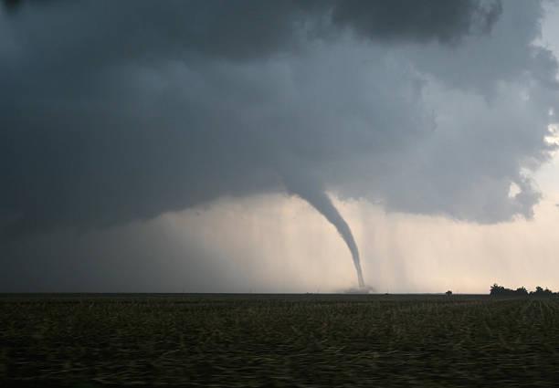 dangerous tornado on the plains - tornado stockfoto's en -beelden