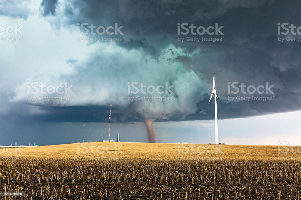 Dangerous tornado with wind generator and communications towers stock photo
