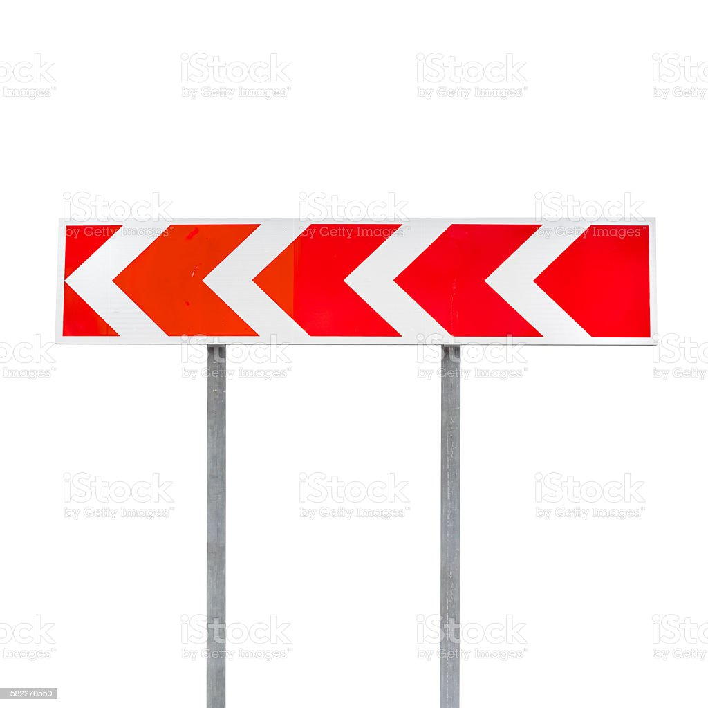 Dangerous turn. Red and white stripped arrow stock photo