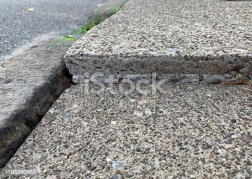 Tripping hazard sidewalk.